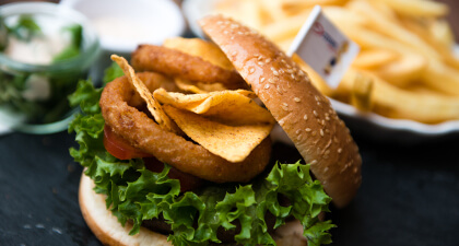 burger with crisp lettuce onion rings and chips or fries
